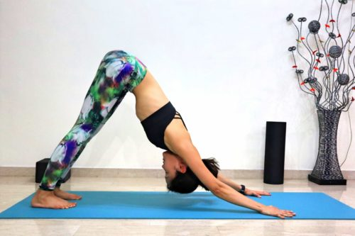 Downward Dog (Adho Mukha Svanasana) - Get step by step instructions and more yoga pose inspirations at https://theyogamad.com