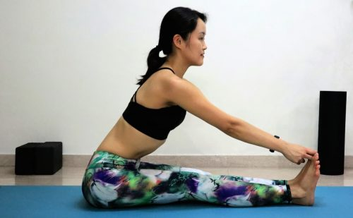 Seated forward fold variation [Paschimottanasana] - Yoga poses for beginners (see more at https://theyogamad.com)