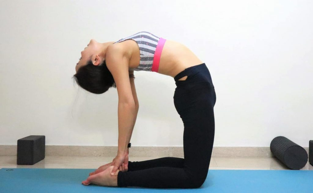 Camel Pose [Ustrasana] - Get step-by-step instructions on yoga poses at https://theyogamad.com