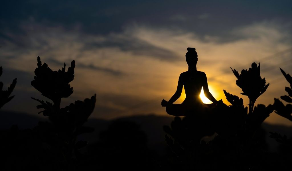 Read more about the article Is Yoga a Sport or Religion? [Neither – Here's What It Is]